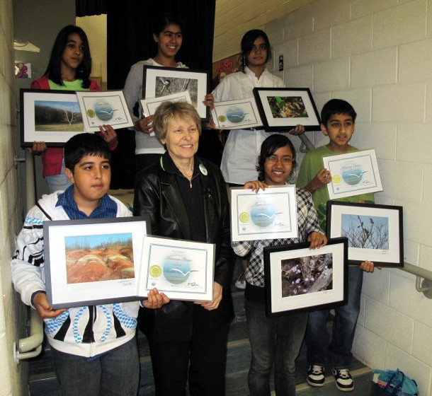 Dr Bondar with SBBC winners who hold their Foundation certificates and their winning images framed & mounted as art prints