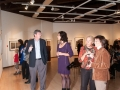 Patrons discuss photographs at the Traveling Exhibition and Learning Experience