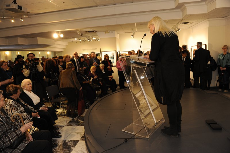 Brenda Parres, Arts and Events Director, First Canadian Place, addresses gallery patrons at The