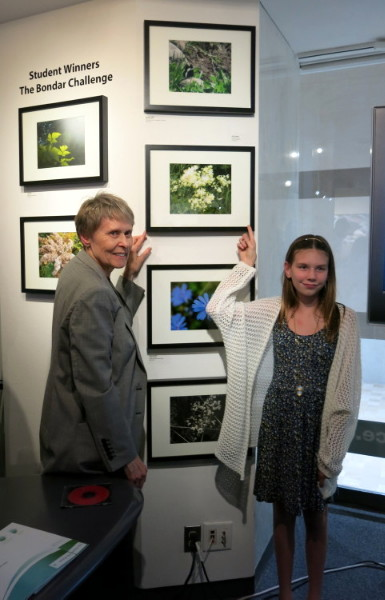 "Dr Bondar with Lydia Charters and her image ""Firework Flowers"" -- First place Emerald Level Winner, 2014 Summer Camp Bondar Challenge  (Camp Centennial NB)"
