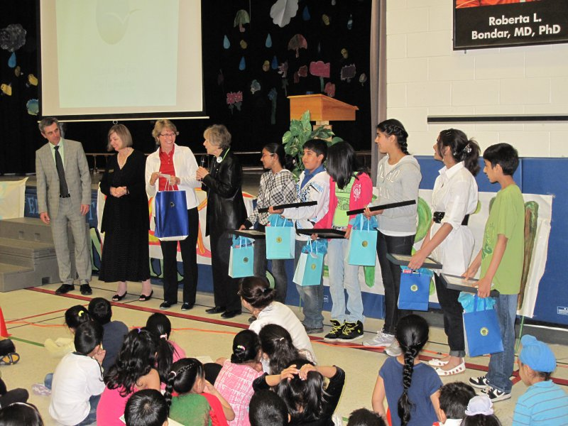 Dr Roberta Bondar with representatives of the School Board, Librarian of the School and student winners being presented their prizes in front of the school assembly