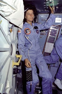 Mission Specialist Sally Ride floats alongside the middeck airlock hatch during the STS-7 mission aboard Space Shuttle Challenger.