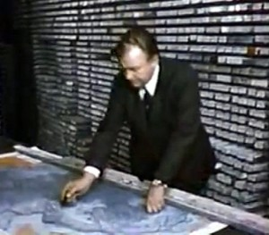Surrounded by stacks of core samples from the Atlantic ocean floor, oceanographer and marine geologist Bruce Heezen demonstrates features of the continental shelf.