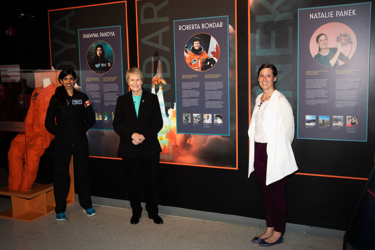 Ontario Science Centre: Standing by their #WomenInSpace Posters - Dr Shawna Pandya, Dr Roberta Bondar, Natalie Panek