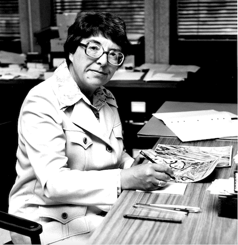 Dr Betty I Roots at her desk [UTM archive]